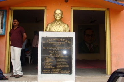 Ambedkar holds his head high, right next to a Hindu temple, representative of higher castes